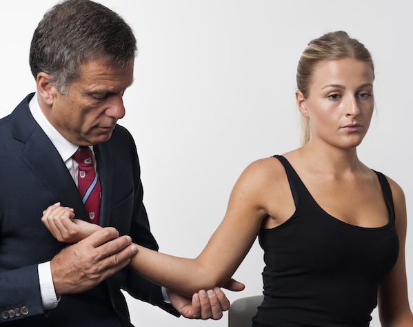 Mr Kossmann applies the Tinel's sign to ascertain whether an ulnar entrapment has occurred at the medial elbow